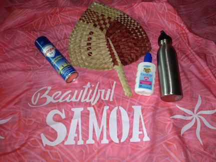 Samoan survivial kit - insect repellent, sunblock, water, fan, and a cool sarong