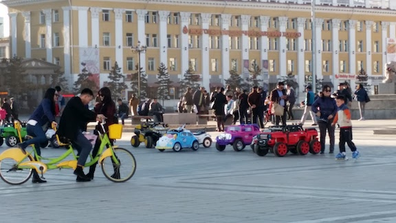 mongolians enjoying bikes and trikes