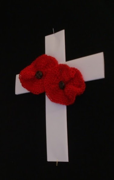poppies on white ribbon cross