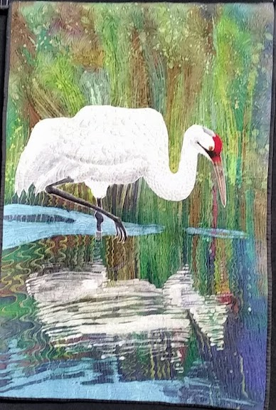 whooper image in water quilt.jpg