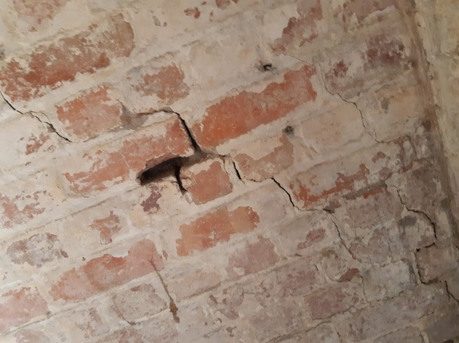 close up of cracks in bricks