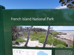 french island sign with bee