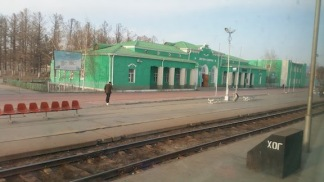 leaving Mongolian stations - farewell to green buildings